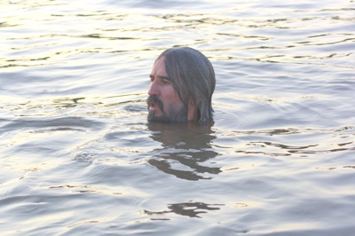 Driftwood Johnnie himself (aka John Ruskey) taking a dip in his beloved Mississippi River. Photo by The Delta Bohemian