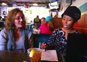 Magical Madge and graphic designer Khara Woods meet to discuss the Delta Bohemian logo design