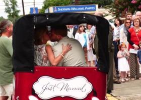 Newlyweds Jill and Jay Salter enjoy a smooch in the DB Pedicab.