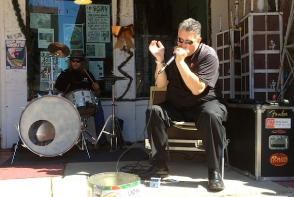 W.C. Handy Award-winning harp player Jeff Stone playing in front of CatHead in Clarksdale