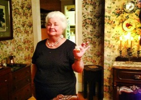 Martha Jane Howell holding after dinner libation