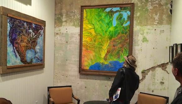 John Ruskey looking at the installation of his large giclée on the left and his original artwork on the right.