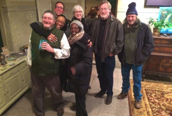 A cluster of friends around Poor William following the Barefoot Workshops premiere at Clarksdale Train Depot.