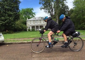 Santana Tandem Vacation cycles pass in front of historical Clark House Residential Inn in Clarksdale. Photo by Charles Evans